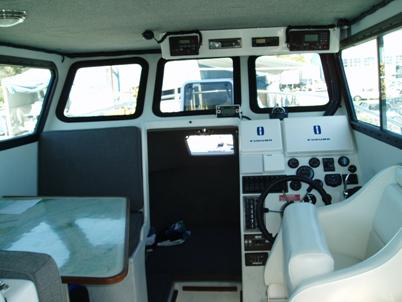 Interior cabin with dinette at left