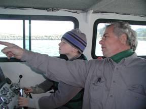 Brandon driving the boat