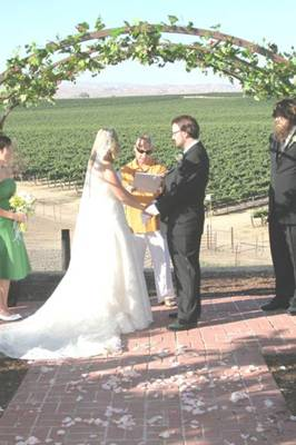 Mario performs the ceremony as matron of honor Taunya Rose and best man Matt Lydon observe