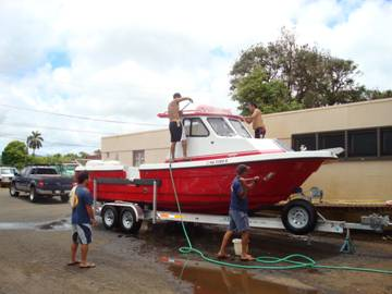Cleaning up the new boat after the sea trial at the fire station