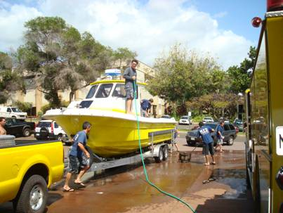The whole crew washes the boat down afterwards