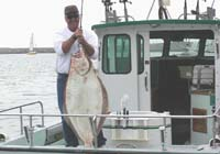 Tom Stubbs with Near Record Halibut